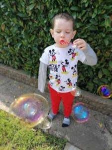 Blowing and catching bubbles is a great way for children to develop hand/eye coordination!
