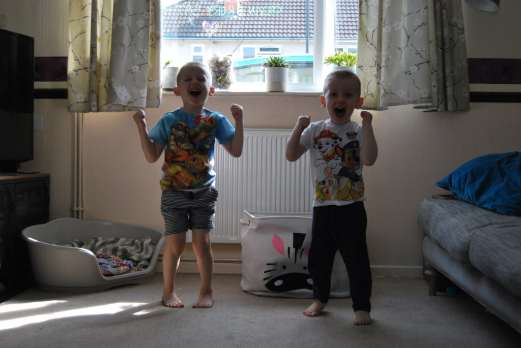 Children celebrating doing their exercises and workouts at home