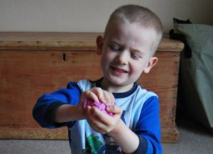 Paper scrunching is an easy and fun way for hand and shoulder strengthening