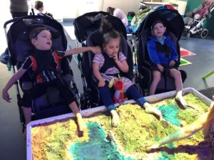 Using sand as a dry messy play activity